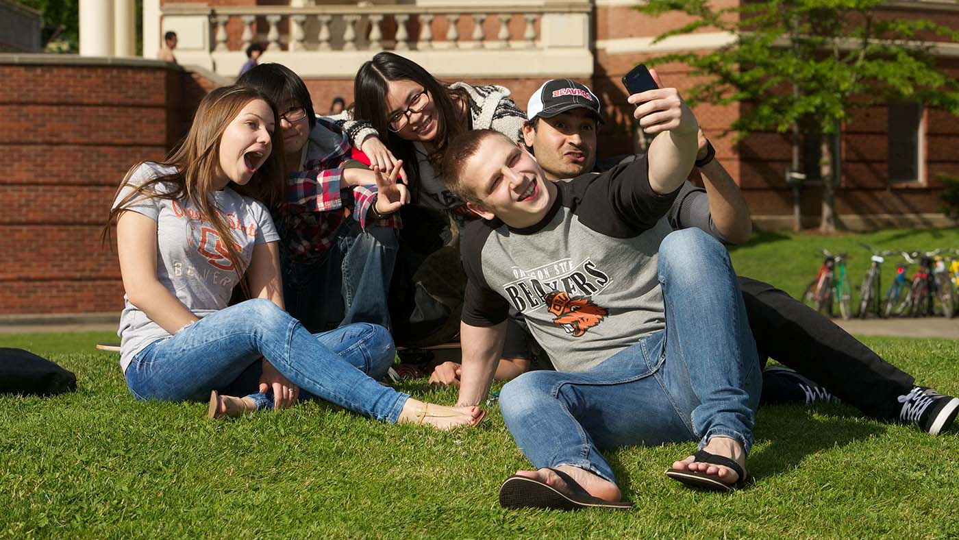 INTO-OSU-living-students-taking-selfie