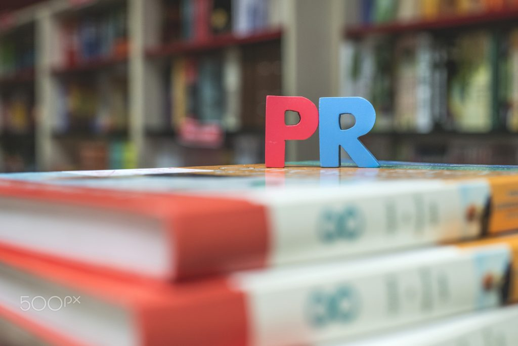 Word PR. Wooden letters.