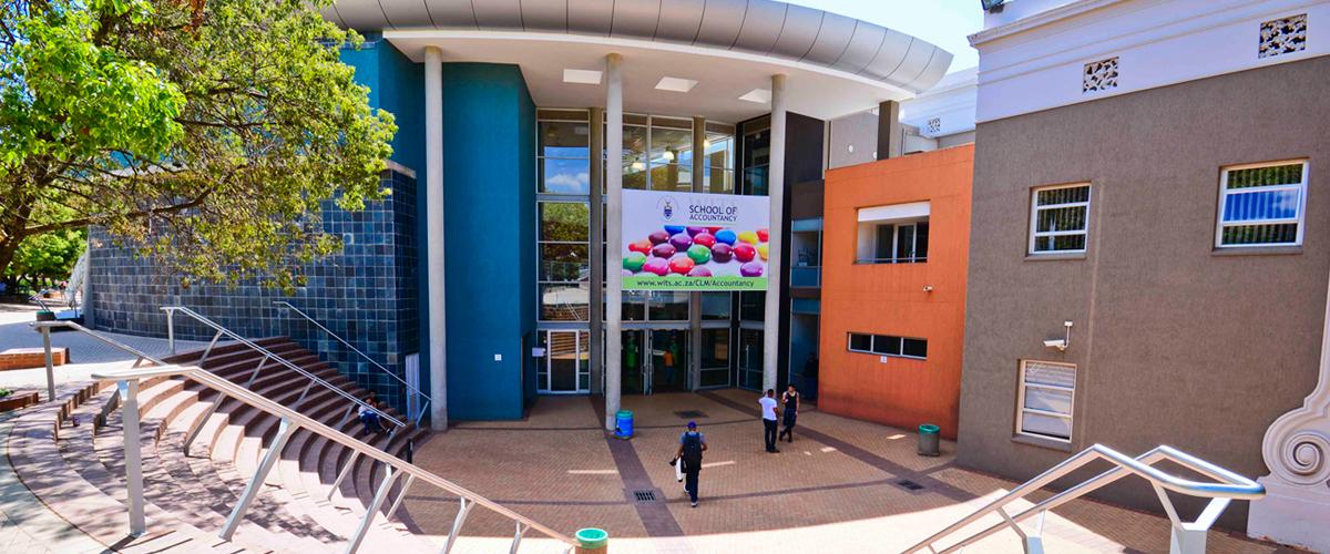 School-of-Accountancy-banner-on-building-1200-x-500