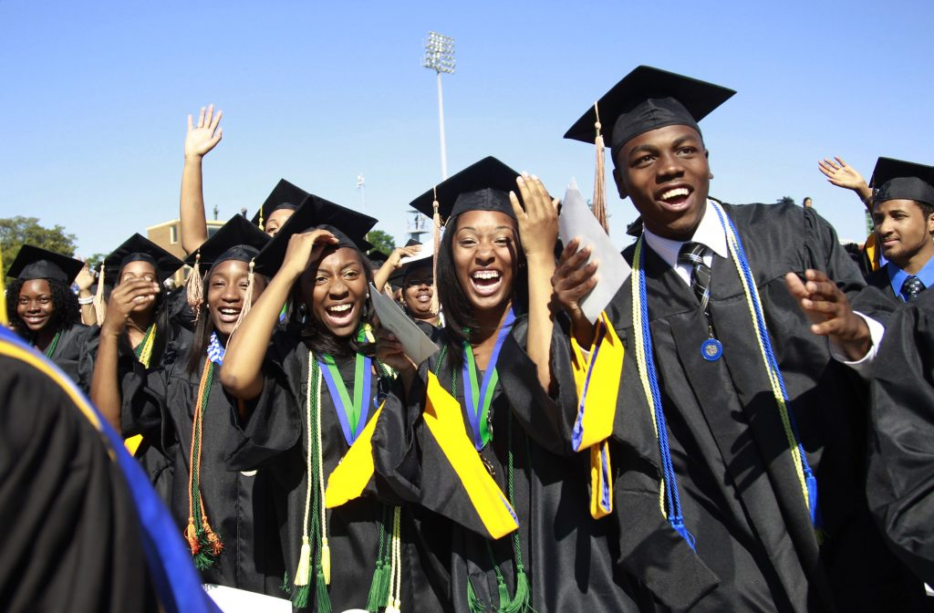 Students react during the graduation ceremony of the 2010 class at Hampton University in Virginia May 9, 2010. U.S. President Barack Obama delivered the commencement address at the graduation and was conferred an honorary doctor of laws degree. REUTERS/Jason Reed (UNITED STATES - Tags: POLITICS EDUCATION IMAGES OF THE DAY) - RTR2DNV8